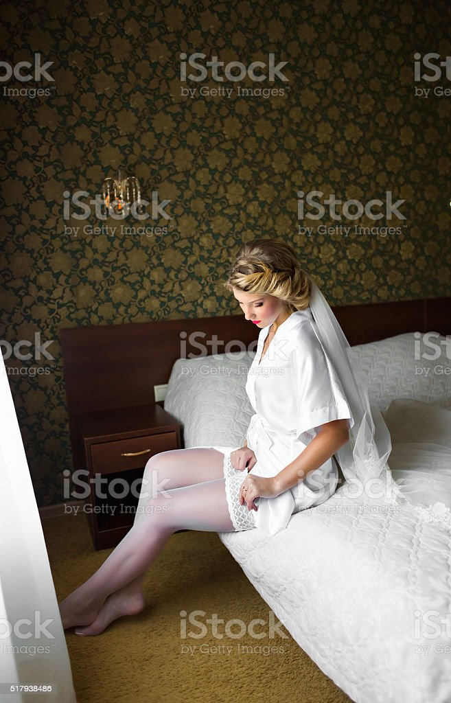 Beautiful caucasian bride getting ready for the wedding ceremony stock photo