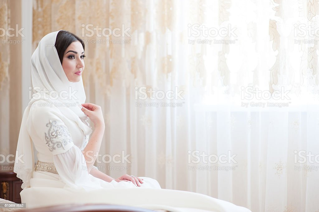 beautiful caucasian bride in traditional dress stock photo