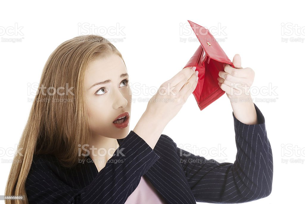 Beautiful caucasian business woman is checking empty wallet. stock photo
