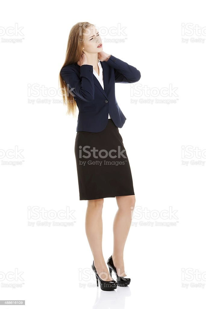 Beautiful caucasian business woman is touching her neck. royalty-free stock photo