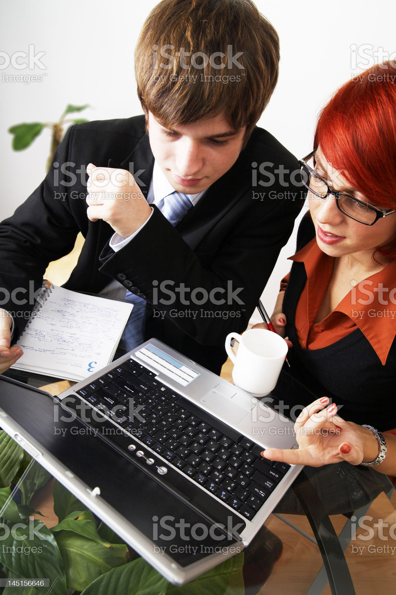 beautiful caucasian business woman with young consultant royalty-free stock photo