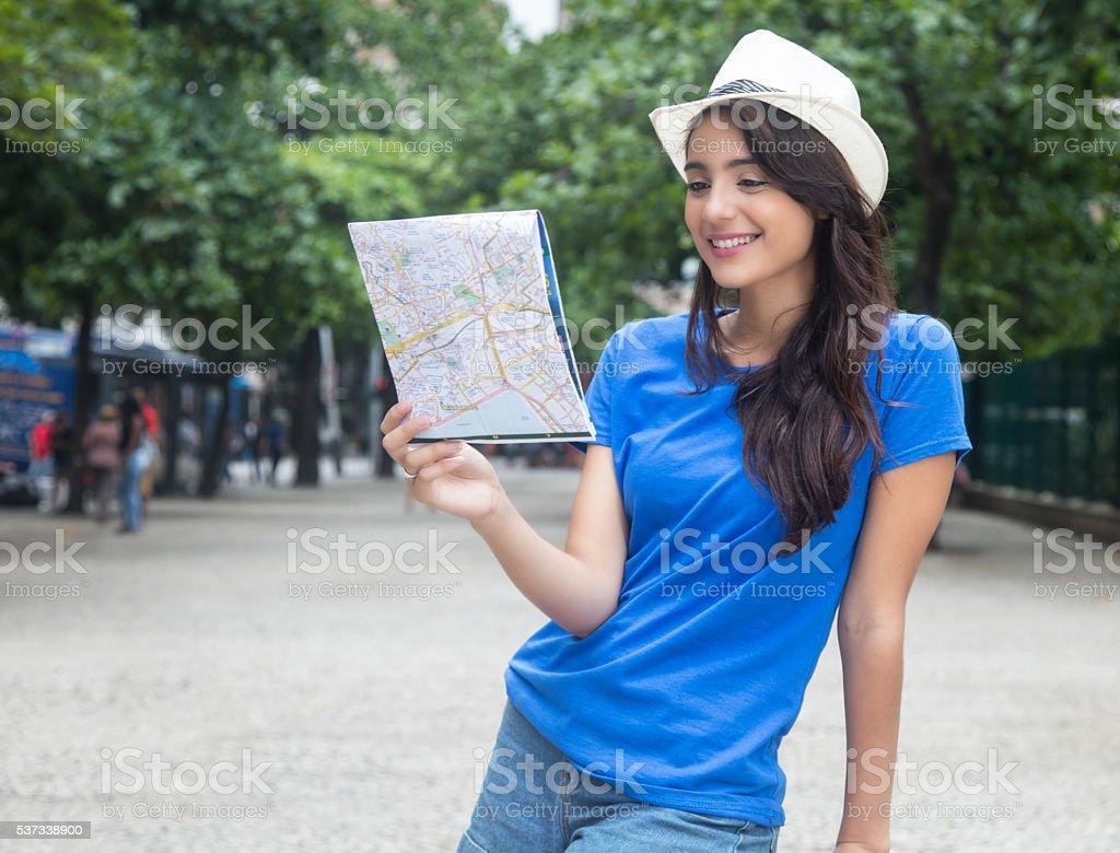 Beautiful caucasian female tourist with map stock photo