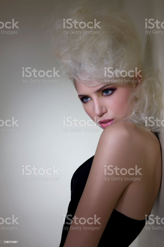 Beautiful Blond Young Woman Fashion Model with Bouffant Hairstyle royalty-free stock photo