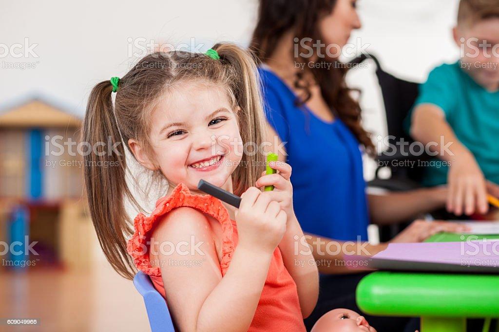 Beautiful Caucasian little girl in her preschool class stock photo