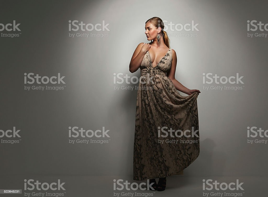 Beautiful caucasian woman in an elegant cocktail dress stock photo
