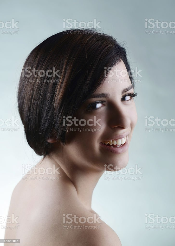 Beautiful caucasian woman on isolated background with smooth skin royalty-free stock photo