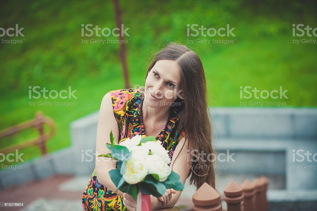 beautiful Caucasian woman with flowers in nature royalty-free stock photo