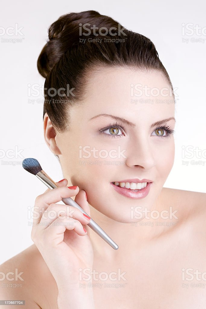 Beautiful Caucasian Young Woman Beauty Model with Makeup Brush, Updo royalty-free stock photo