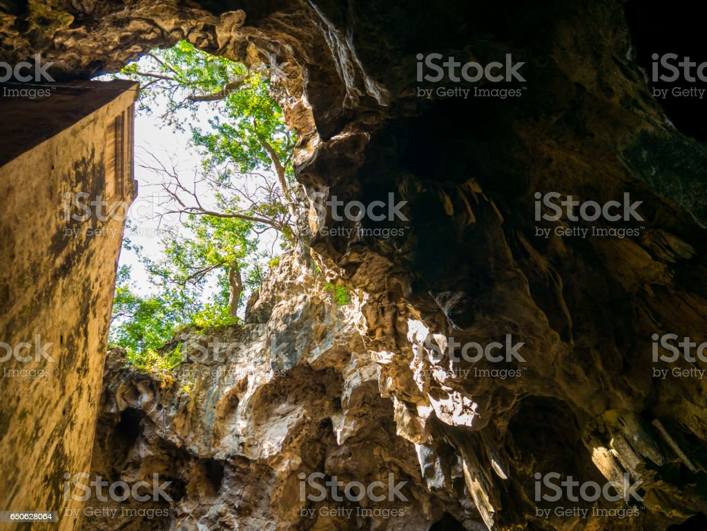 Beautiful cave entrance with sun beam stock photo