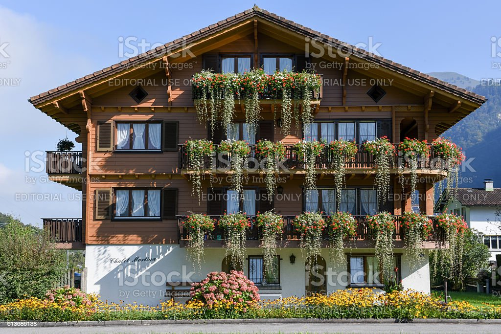 Beautiful chalet adorned with flowers at Wolfenschiessen, Switze stock photo