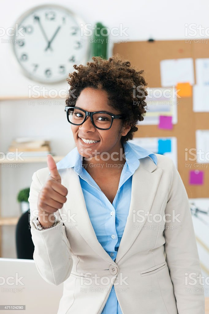 Beautiful cheerful young woman at office stock photo