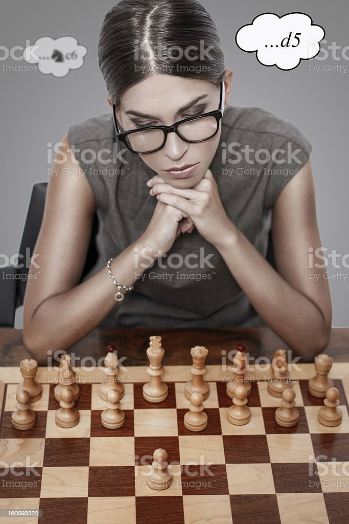 Beautiful chess player thinking royalty-free stock photo