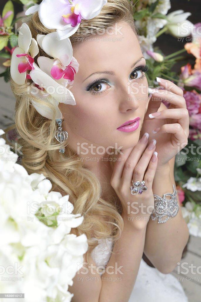beautiful chic woman around the flowers. royalty-free stock photo
