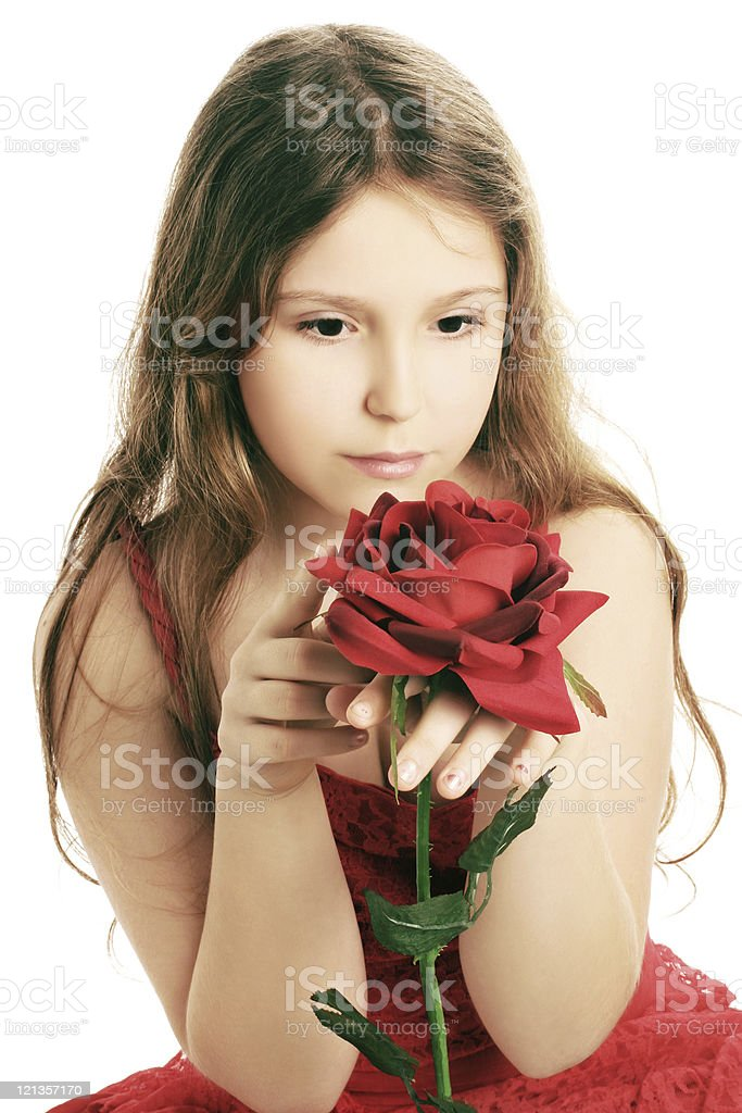 Beautiful child girl with flower red rose stock photo