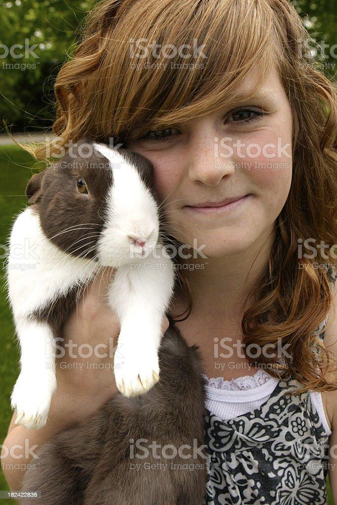 Beautiful Child Holding Rabbit royalty-free stock photo