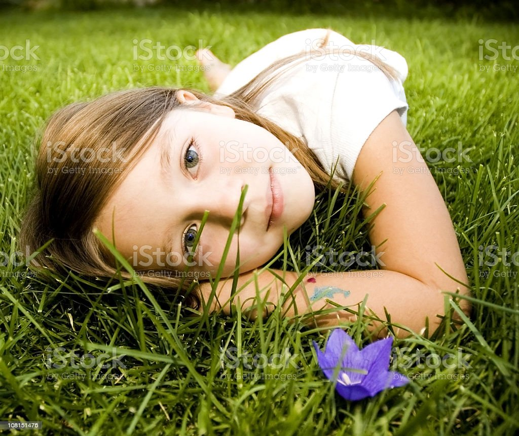 Beautiful Child Laying on Grass stock photo
