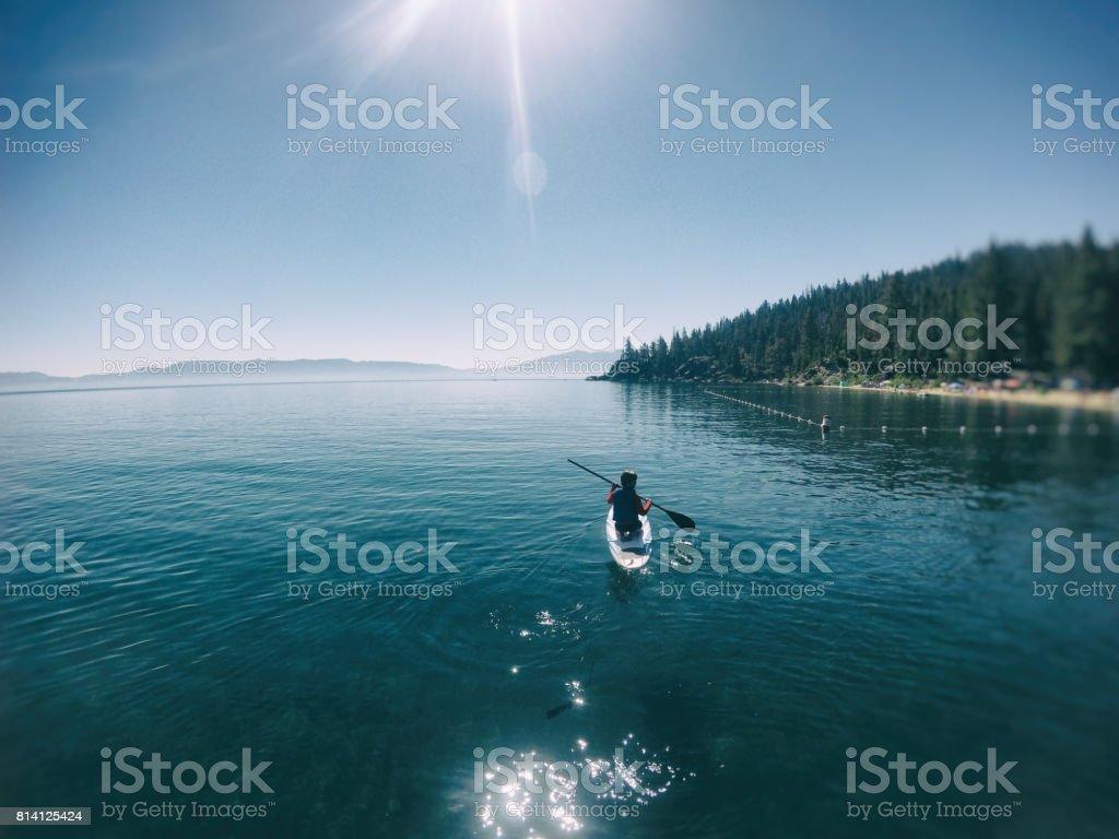 Beautiful child outing on lake stock photo