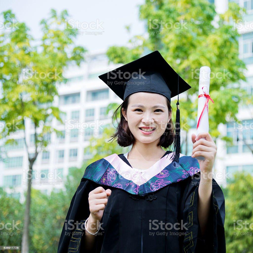 Beautiful Chinese college graduate stock photo