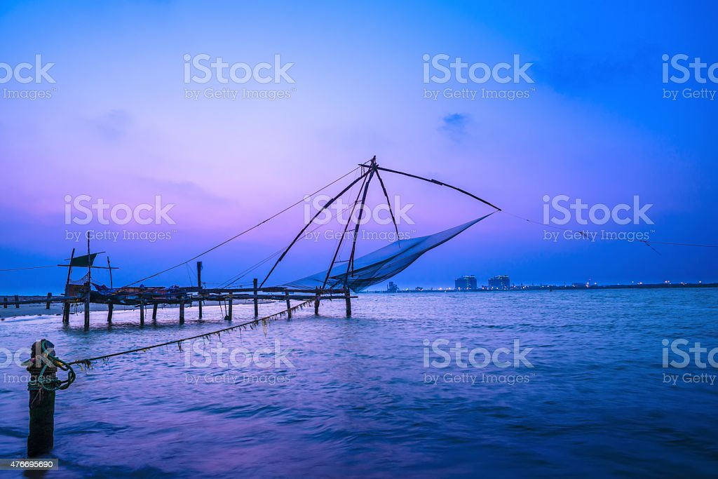 Beautiful chinese fishnets in twilight Kochi, Kerala. Fort stock photo
