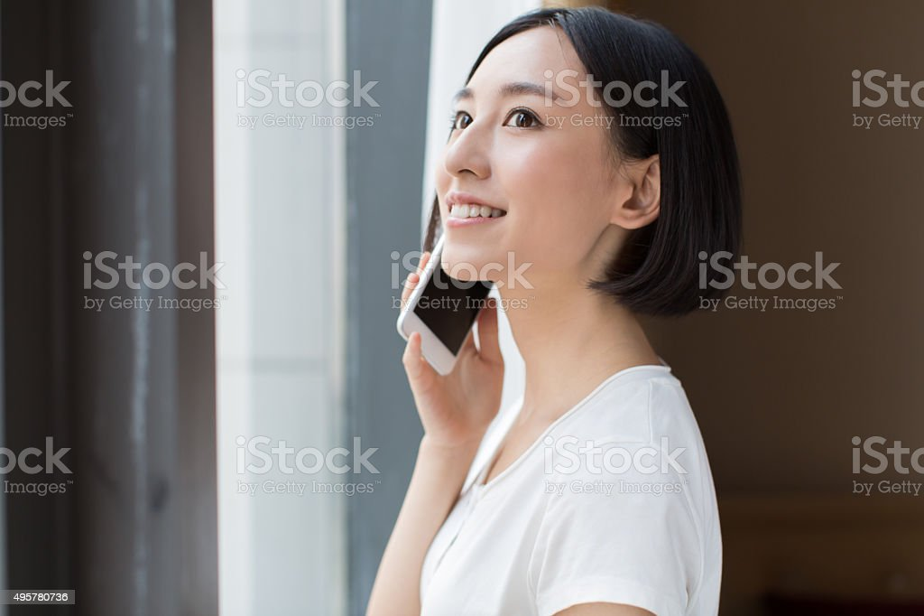 beautiful chinese girl in hotel stock photo