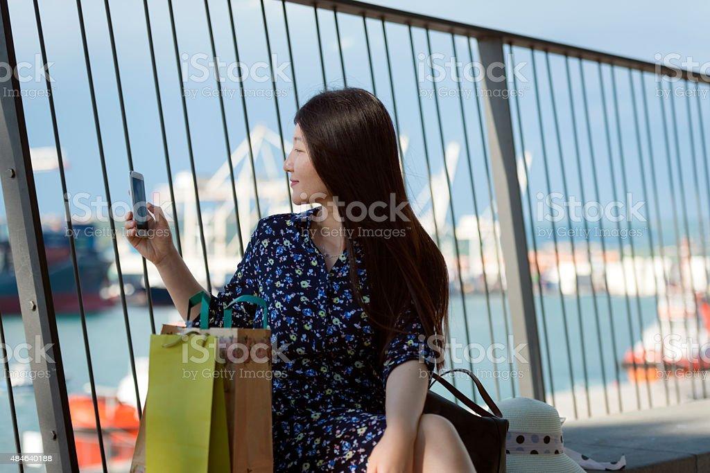 Beautiful Chinese Woman Photographing Koper, Slovenia, Europe stock photo