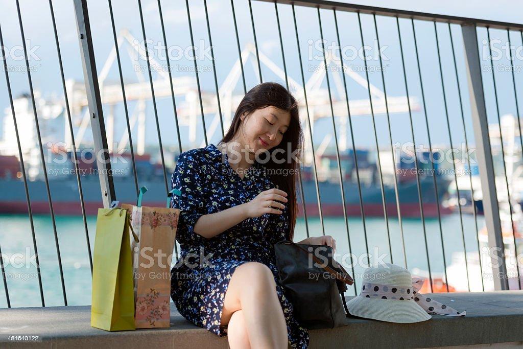 Beautiful Chinese Woman Shopping in Koper, Slovenia, Europe stock photo