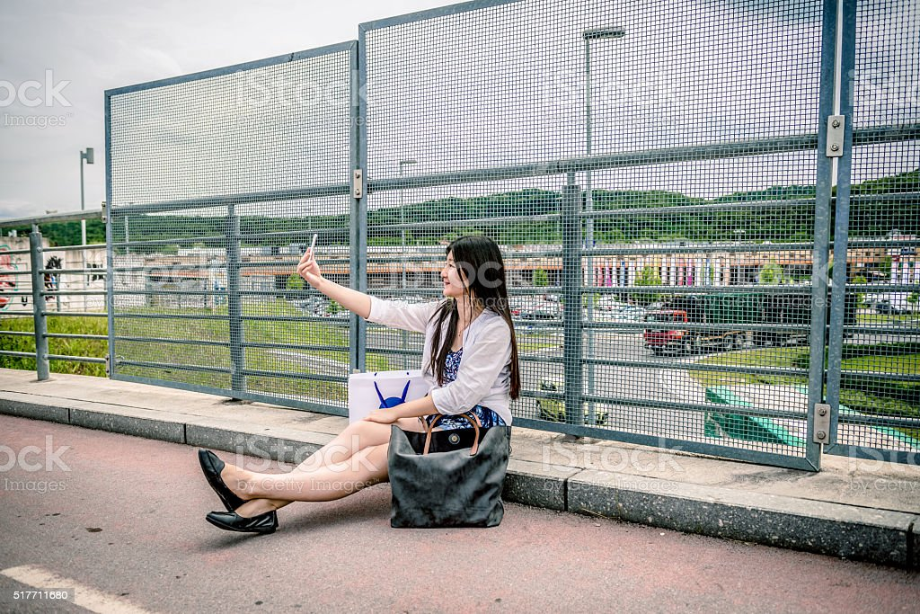 Beautiful Chinese Women Taking Selfie after Shopping, Roundabout, Europe stock photo