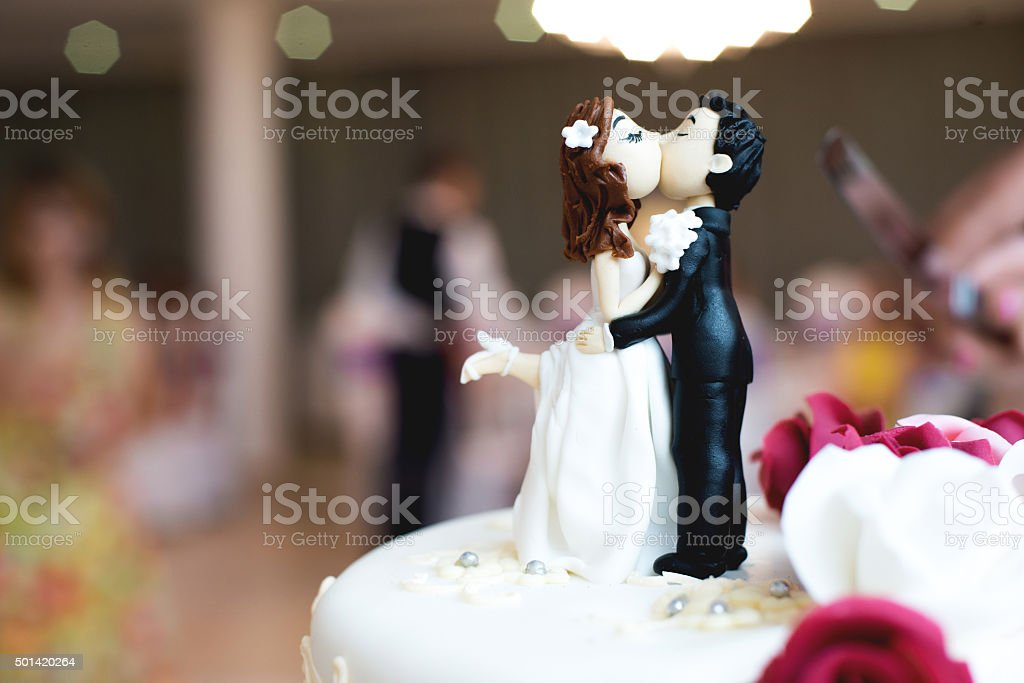 Beautiful chocolate figurines on top of wedding cake stock photo
