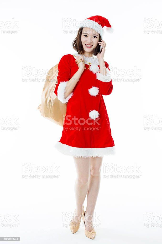 Beautiful christmas girl holding a gift bag stock photo