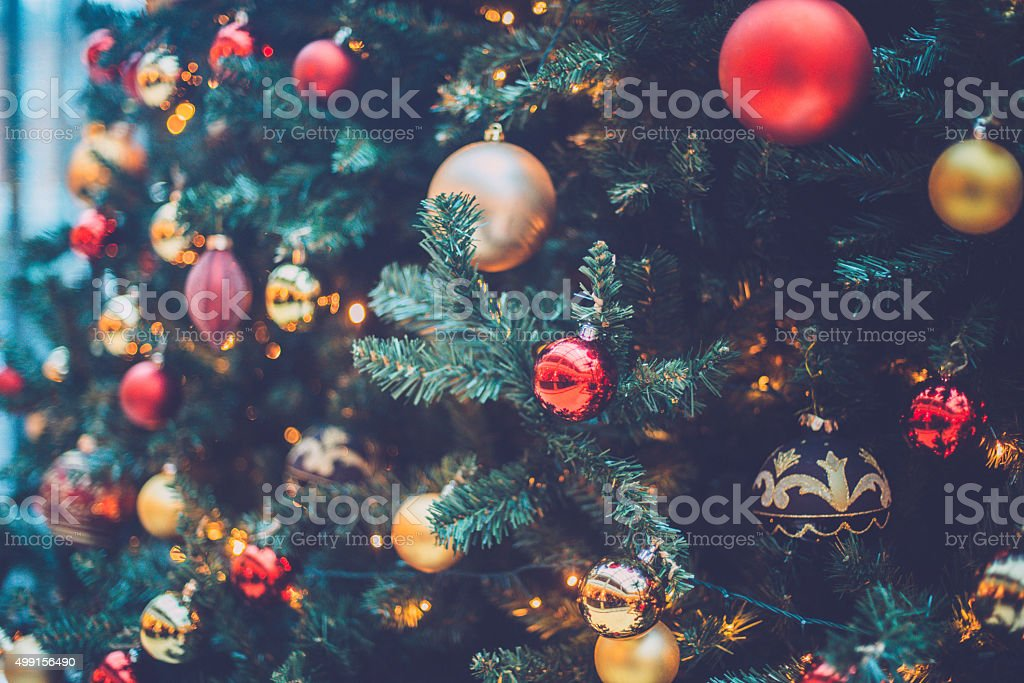 Beautiful Christmas Tree with Red and Gold Baubles Close Up stock photo