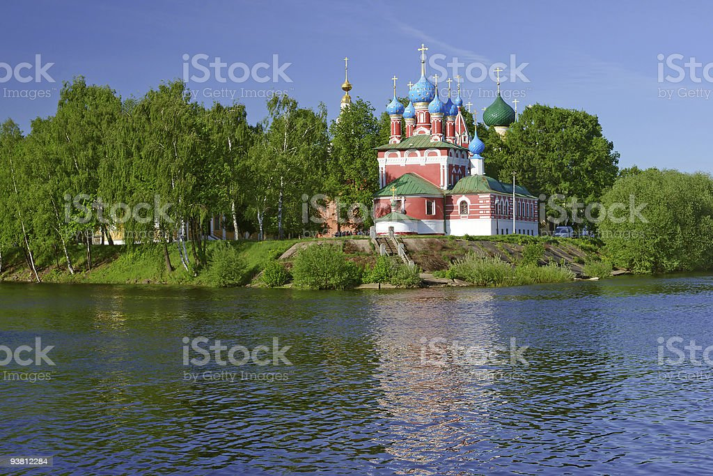 Beautiful church in forest over the river stock photo