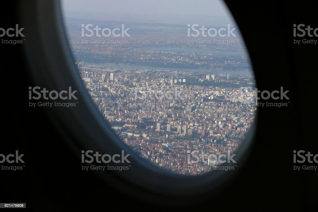 Beautiful city Belgrade view with blue sky from plane window stock photo