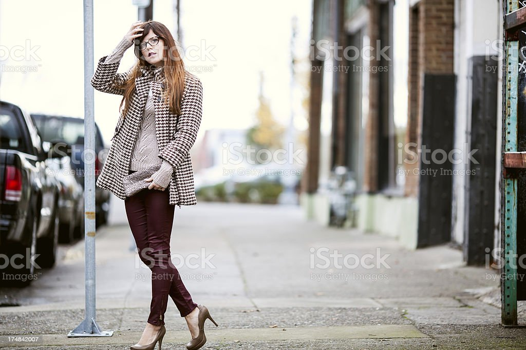 Beautiful City Fashion Model Stroking Brown Hair stock photo