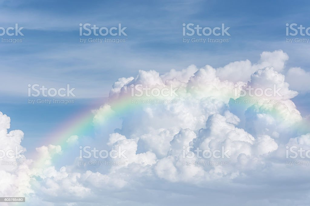 beautiful classic rainbow across in the blue sky stock photo