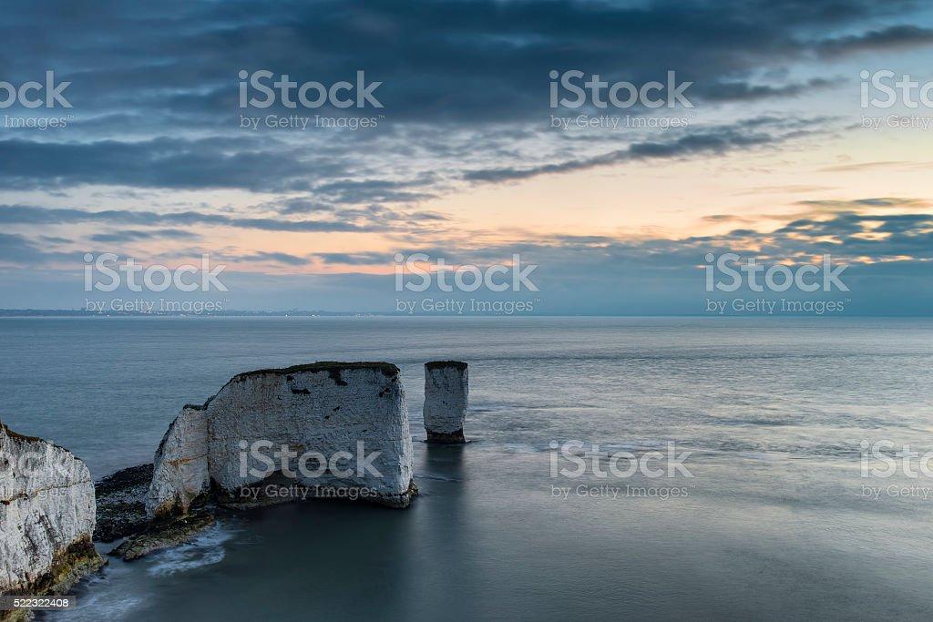 Beautiful cliff formation landscape during stunning sunrise stock photo