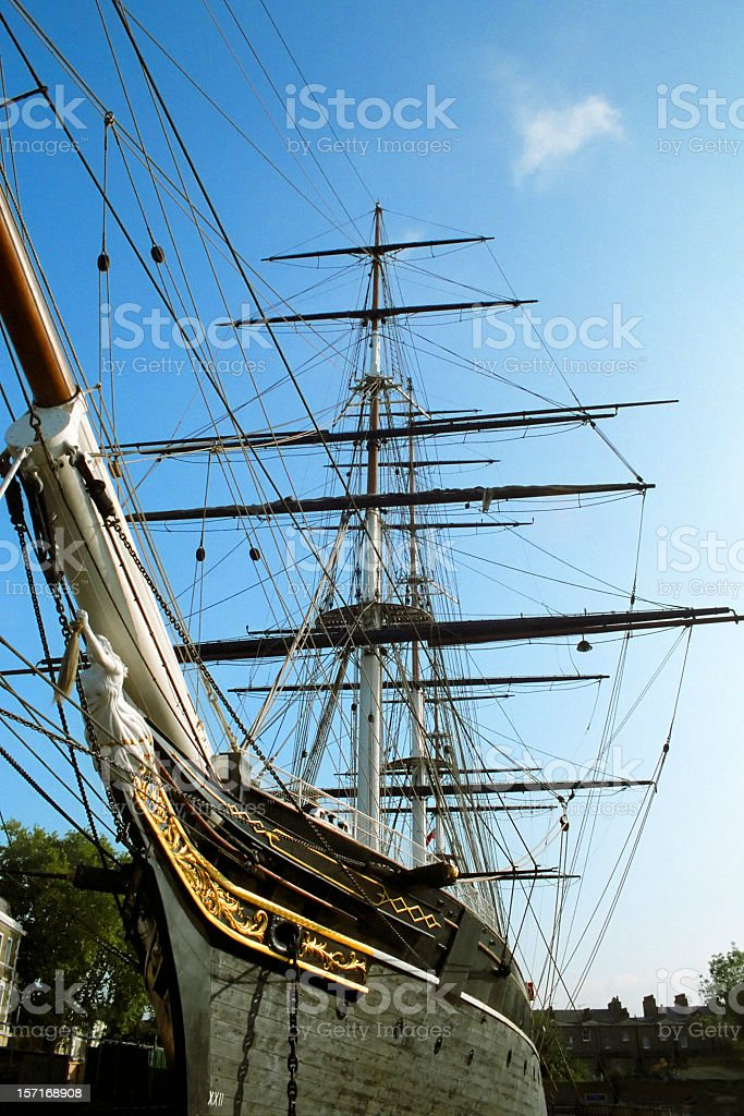 Beautiful clipper ship with sails rolled up stock photo