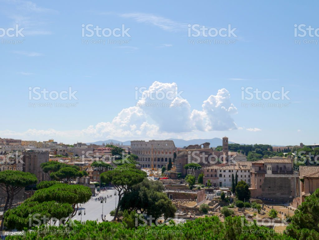Beautiful clouds above coliseum, view of the Colosseum and the Roman Forum, Rome, Italy. stock photo