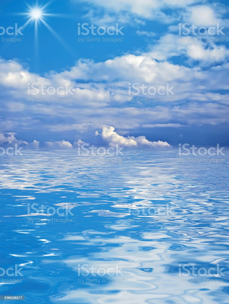 beautiful clouds over the water stock photo