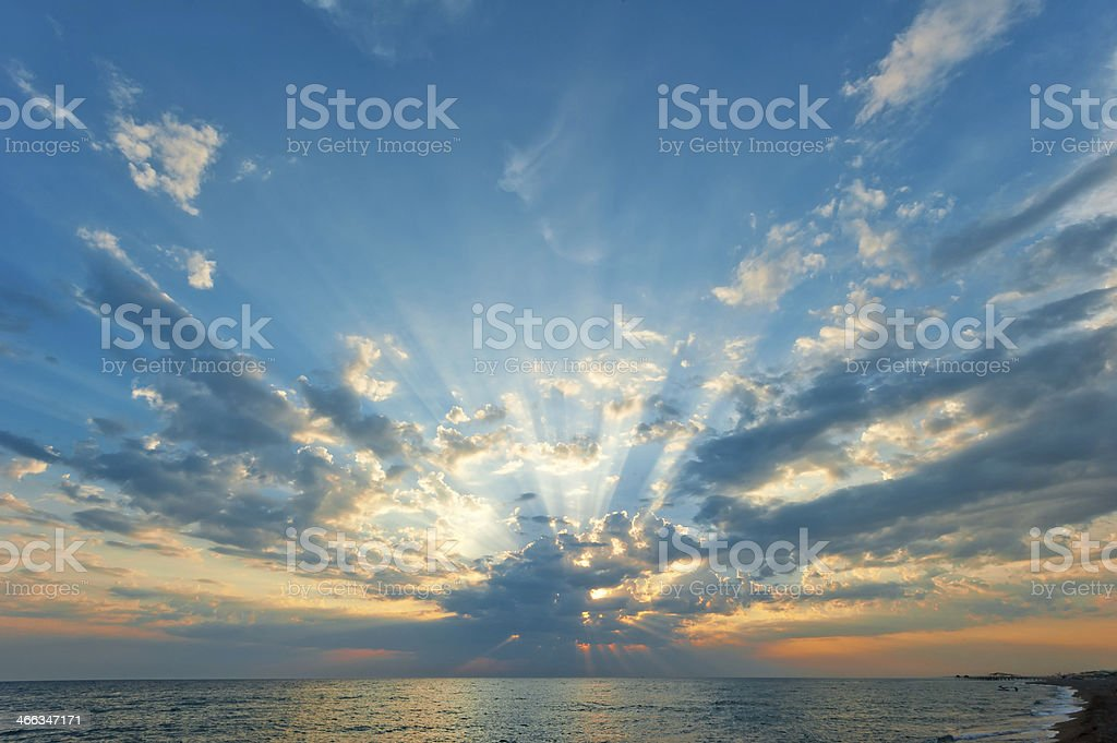 beautiful clouds with the setting sun over  sea royalty-free stock photo