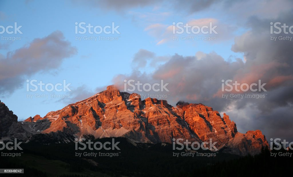 Beautiful cloudy sky at sunset in the Dolomites at La Villa, Alta Badia. Italy. stock photo