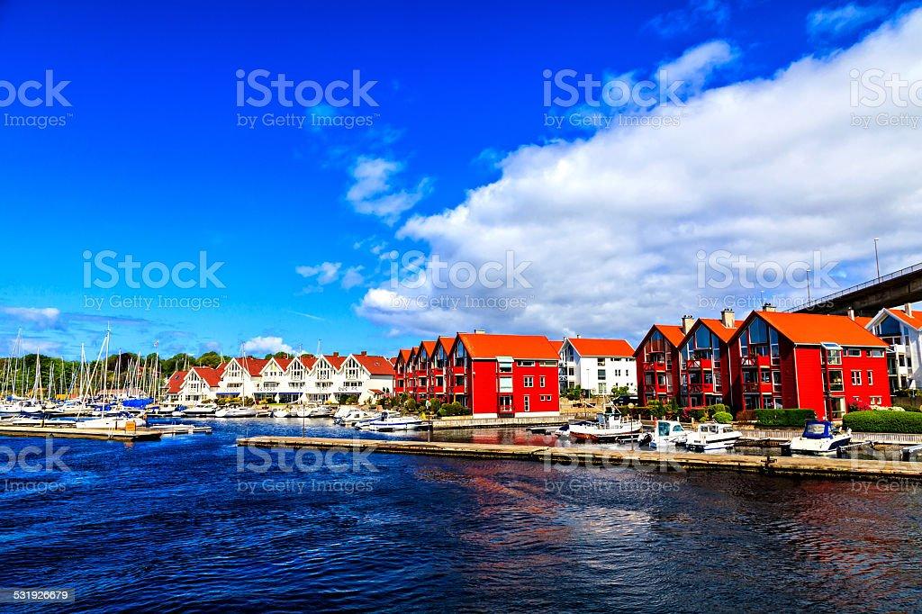 Beautiful coastal landscape: harbor, yachts and houses stock photo