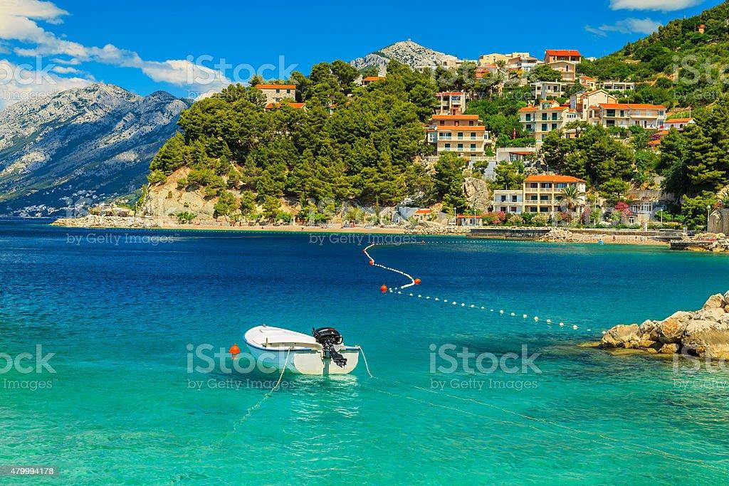 Beautiful coastline and beach with motorboat,Brela,Dalmatia region,Croatia stock photo