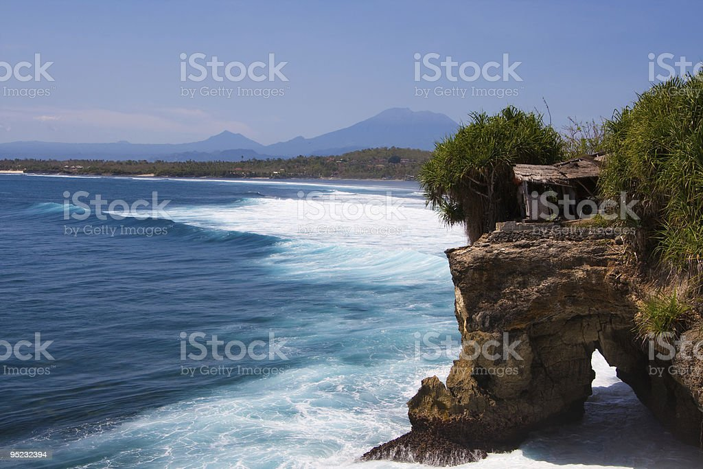 Beautiful coastline waves against rocky shore stock photo