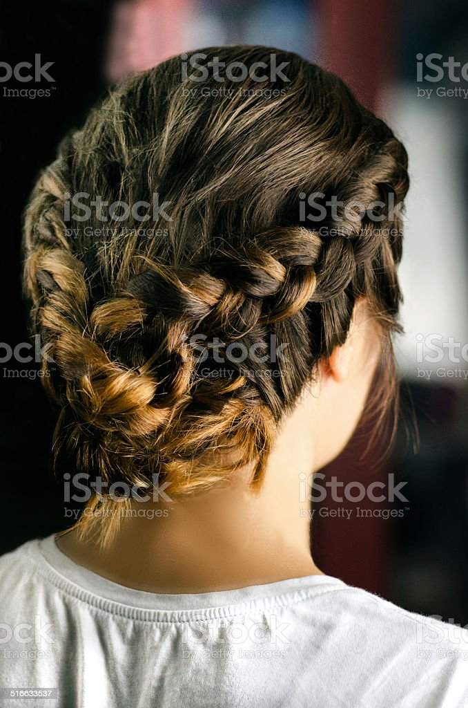 Beautiful coiffure from pigtails stock photo