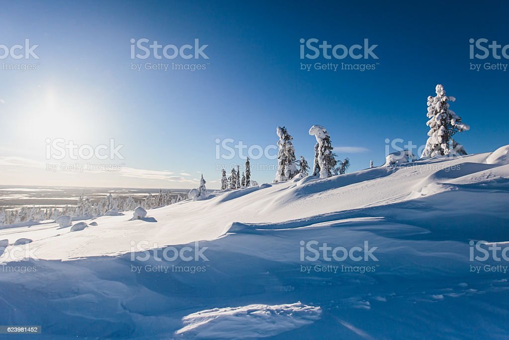 Beautiful cold mountain view of ski resort, sunny winter day stock photo