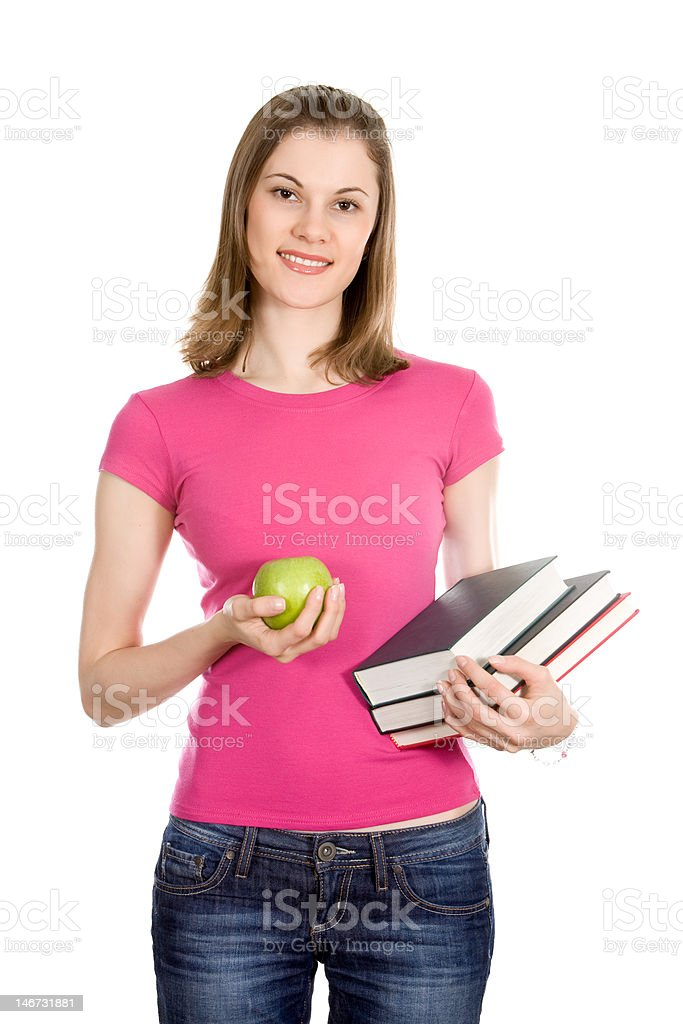 Beautiful college girl with books and apple. Isolated on white royalty-free stock photo