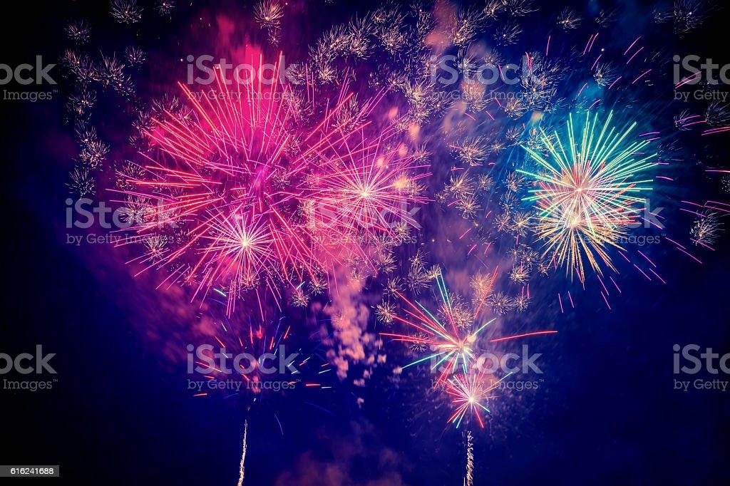 beautiful colorful firework at night stock photo