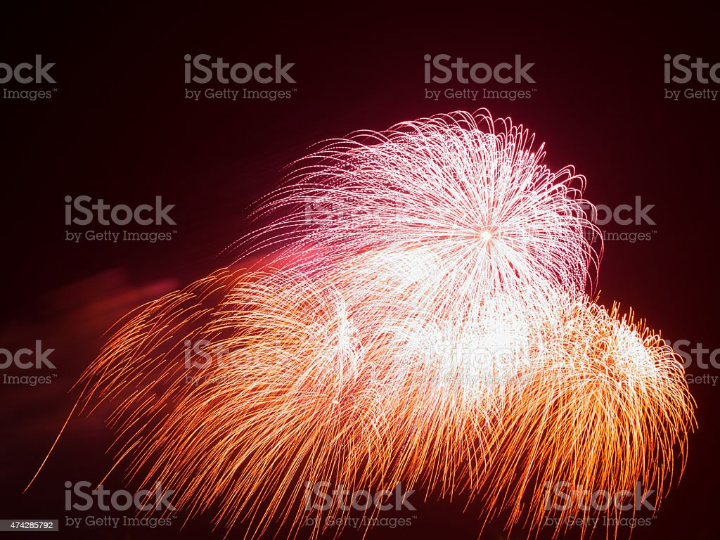 beautiful colorful red and orange fireworks stock photo