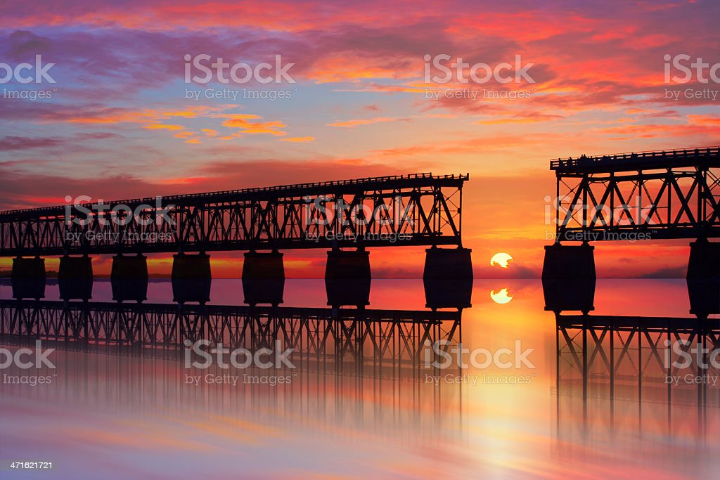 Beautiful colorful sunset or sunrise with broken bridge stock photo
