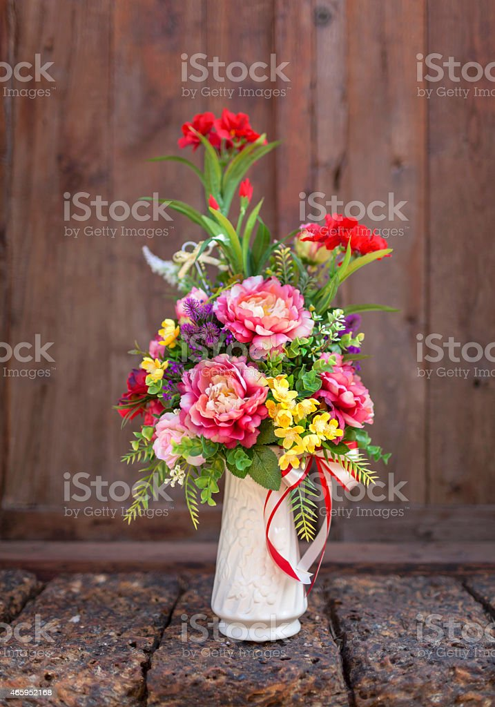 Beautiful colourful flower in long  vase royalty-free stock photo